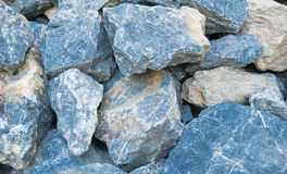 Big stone. Pile of big blue and brown stone wall for background Royalty Free Stock Photo