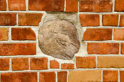 Big stone in red brick wall. Architecture closeup Royalty Free Stock Image