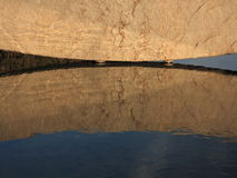 Big stone reflection in water as background Stock Images