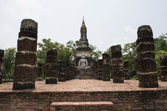 Big stone stone Buddha and stupa at Archaeological Park Buddhist temples of Sukhothai, Thailand. Archaeological Park of Sukhothai Buddhist temples. Wat Mahathat Stock Image