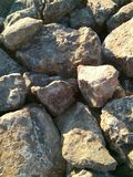 Big stone texture. Big raw stone texture under the sun rays Stock Image