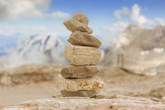 Big stone tower in mountains height show balance stability power Royalty Free Stock Images