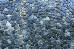 A big stone wall fixing together by cement the wall is same as castle base or some ancient wall in the past created pattern textur Royalty Free Stock Photos