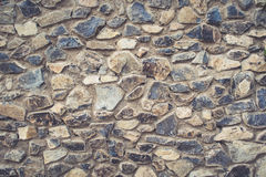 Big stone wall texture in warm colors. Big stone wall texture in blue, gray and beige colors royalty free stock photos