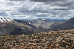Big stones on the background of valley and high mountain snow peaks ranges Stock Images