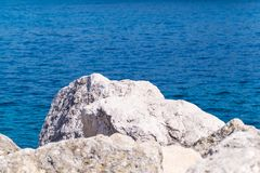 Big stones boulders against the sea Stock Image