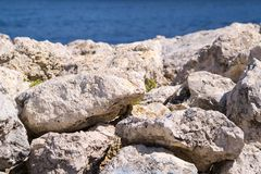 Big stones boulders closeup against the sea Stock Photography