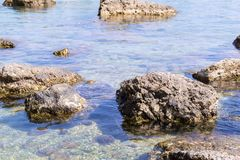 Big stones boulders lie in water of the sea coast Stock Image