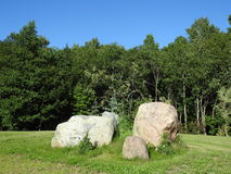 Big stones on grass. Big beautiful natural stones and summer plants, Lithuania Stock Image