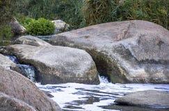 Big stones in mountain river Stock Photo