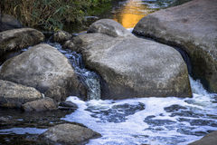 Big stones in mountain river Stock Images