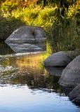 Big stones in mountain river Stock Photos