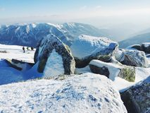 Big stones in mountains. Beautiful and unusual landscape of mountains with stones and snow Royalty Free Stock Photos