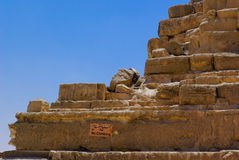 Big stones pyramid close-up. Pyramid ruins in Giza, Cairo, Egypt. Big stones close-up on the blue sky backdrop Royalty Free Stock Image