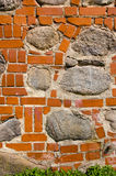 Big stones in red brick wall. Architecture closeup Stock Photography
