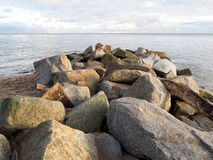 Big stones on the seashore Stock Images