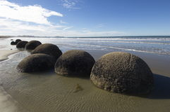 Big stones at seaside. Large boulders uncovered by the receding tide Stock Photography