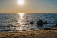 Big stones in the water - peaceful evening seaside. Background stock photos