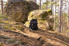 Big stones in the wood with bagpack. Big stones in the woods with a bagpack in the middle Stock Images