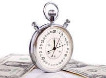 Big stopwatch with money Royalty Free Stock Photography