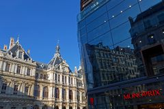 Big store reflection of Trade House of Lyon. LYON, FRANCE, March 19, 2018 : Reflection of the trade house of Lyon in glass facade of a big store Stock Photos
