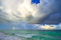 Big storm clouds in sky above blue sea. Dramatick background stock photo