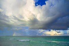 Big storm clouds in sky above blue sea. Dramatick background royalty free stock images