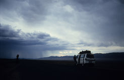 Big storm on Kazakstan. Some photographer make picture on the road Royalty Free Stock Image