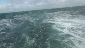 Big storm waves in the sea. View from the stern of the ship