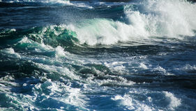 Big stormy ocean wave. Blue water background Stock Photos