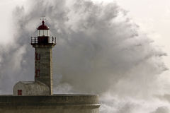 Big stormy sea wave splash over lighthouse Stock Photo