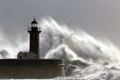 Big stormy waves over old lighthouse Stock Image