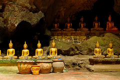 ROWS OF BUDDHA IMAGES IN A CAVE stock image