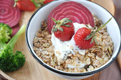 Big Strawberries on Muesli Bowl Royalty Free Stock Images