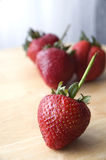 Big strawberry. Close up big strawberry on table Royalty Free Stock Image
