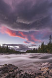 Big stream flowing in beautiful river scape with pink orange sun. Staying in the kvikkjokk fjallstation the river is close. Its a pleasure taking photo`s of the stock photos