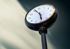 Big street Clock on the blurred sky background Stock Images
