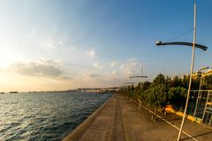 Big street lights near the sea. A picture of big street lights in a road near the sea,in a town in Greece,Thessaloniki Stock Images