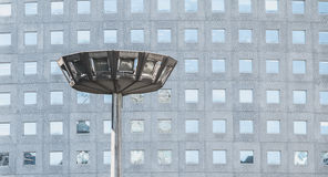 Big streetlight in a business district in front of a skyscraper Royalty Free Stock Photo