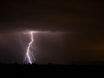Big Strike. A shot of a big lighting strike in the desert Stock Images