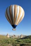 Big striped  balloon over Cappadocia Stock Photo
