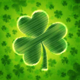 Big striped shamrock in green old paper background with flowers Royalty Free Stock Photo