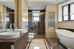 Bathroom with ceramic bath under window. royalty free stock image