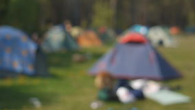 Big summer camping with multi-colored tents stock video