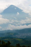 Big Summit of volcano Surrounded By Fog and Clouds Royalty Free Stock Photography