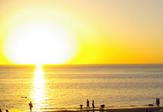 Big Sun, Henley Beach. Photograph taken at sunset from Henley Beach looking towards the Gulf St Vincent, featuring numerous people at the water's edge (Adelaide stock images