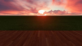 Big Sun Rising Between Clouds in Front of Wooden Planks and Gree. N Ground Stock Photos