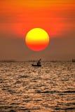 Big sun at sunset time. Sunset and fisherman boat ship fishing fish sea seascape seashore pattaya thailand orange royalty free stock photography