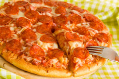 Big Supreme Pizza in pan. A juicy big Supreme Pizza in pan stock images