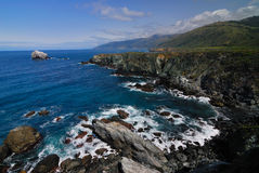 Big Sur. California and Big Sur and the rocky shoreline and cliffs stock photos